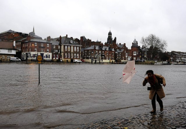 Rising water levels from the River Ouse bring floodwater into riverside roads in York City centre on December 23, 2013, as heavy rain and gales sweep across many parts of the UK. (Photo by John Giles/PA Wire)