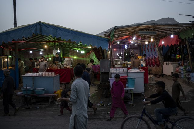 Local vendors wait for customers in Kabul, Afghanistan, Friday, September 10, 2021. (Photo by Bernat Armangue/AP Photo)