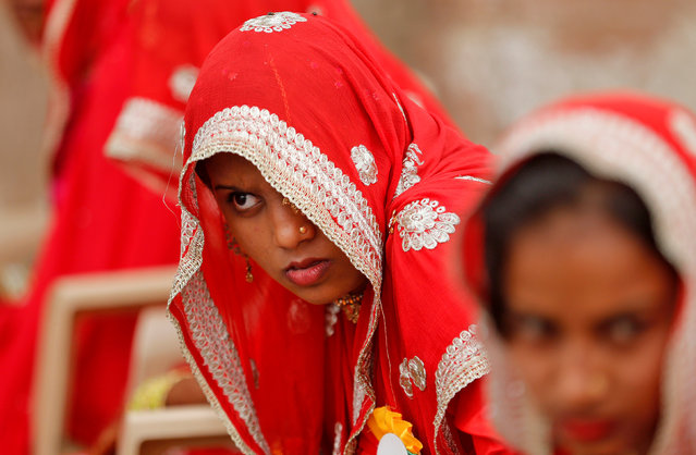 A bride waits to take her wedding vow during a mass marriage ceremony in which, according to its organisers, 111 Muslim couples took their wedding vows, in Ahmedabad, India January 26, 2017. (Photo by Amit Dave/Reuters)