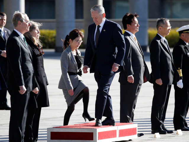 U.S. Defense Secretary Jim Mattis (C) and Japan's Defense Minister Tomomi Inada (3rd L) walk as they review the honour guard at the Defense Ministry in Tokyo, Japan, February 4, 2017. (Photo by Toru Hanai/Reuters)