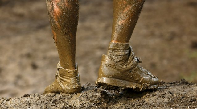 A competitor is seen only wearing one shoe as he participates in the Tough Mudder challenge near Henley-on-Thames in southern England May 2, 2015. (Photo by Eddie Keogh/Reuters)