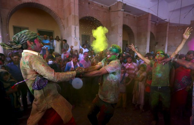 Hindu devotees take part in the religious festival of Holi, also known as the festival of colours, in the town of Barsana in the Uttar Pradesh region of India, March 16, 2016. (Photo by Cathal McNaughton/Reuters)