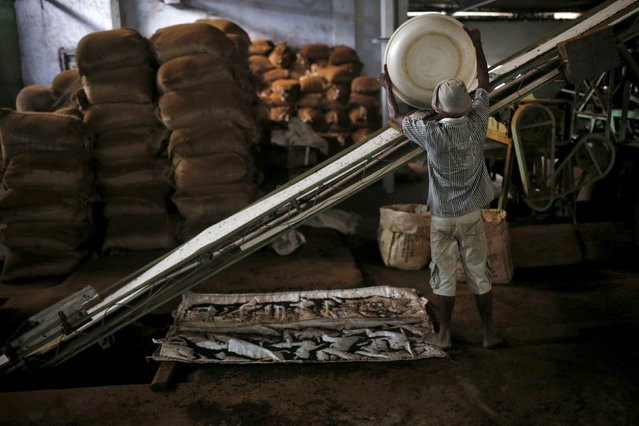 An employee works at a tea production factory inside Aideobarie Tea Estate in Jorhat in Assam, India, April 21, 2015. (Photo by Ahmad Masood/Reuters)