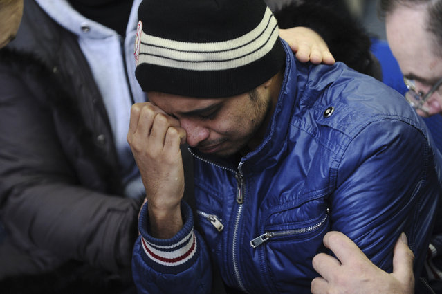 A relative of the plane crash victim sobs as he is comforted by other relatives at the Rostov-on-Don airport, about 950 kilometers (600 miles) south of Moscow, Russia Saturday, March 19, 2016. An airliner from Dubai crashed early Saturday while landing in the southern Russian city of Rostov-on-Don in strong winds, Russian officials said. (Photo by AP Photo)