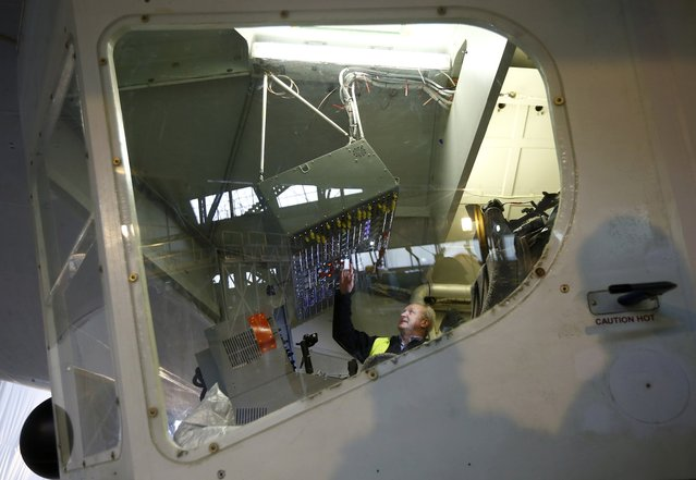 Test pilot David Burns sits in the cockpit of the Airlander 10 hybrid airship during its unveiling in Cardington, Britain March 21, 2016. (Photo by Darren Staples/Reuters)