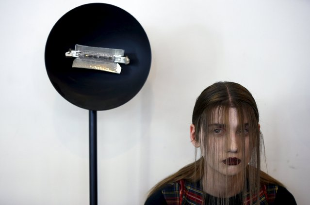 A model waits backstage during the Mercedes-Benz Fashion Days in Tbilisi, Georgia, May 2, 2015. (Photo by David Mdzinarishvili/Reuters)