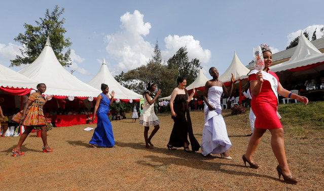 """Miss Langata Prison 2016 Ruth Kamande leads female inmates in participating in a fashion parade as part of their Valentine's Day celebration, dubbed """"love behind bars"""" inside the Langata Women Maximum Security Prison in Kenya's capital Nairobi, February 14, 2017. (Photo by Thomas Mukoya/Reuters)"""