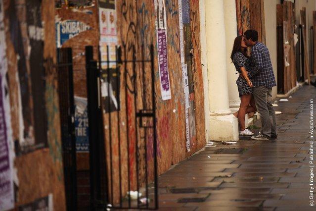 A  couple kiss on the street