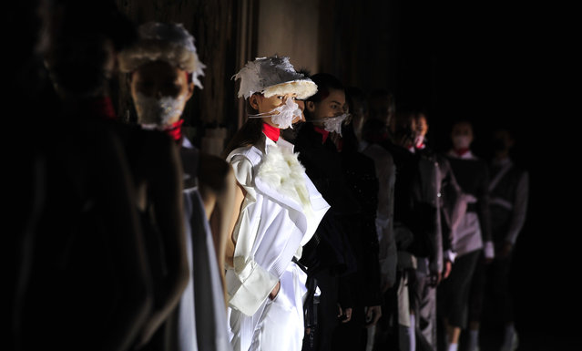 A model wears a creation for Masha Ma's ready-to-wear fall/winter 2014-2015 fashion collection presented in Paris, Wednesday, March 5, 2014. (Photo by Zacharie Scheurer/AP Photo)