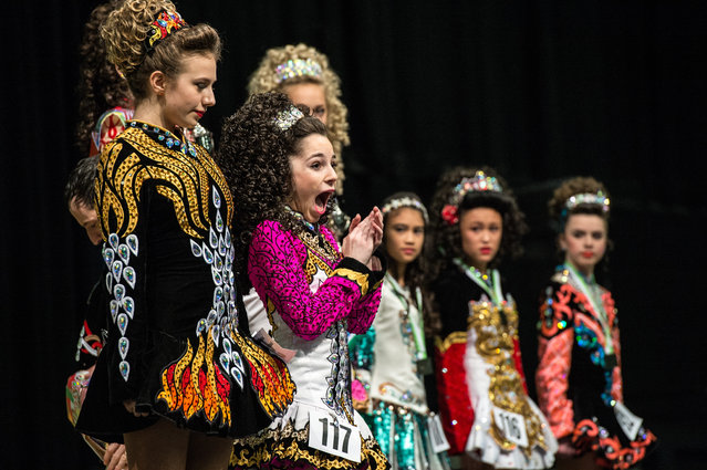 """An Irish dancer celebrates in front of her competitors after winning the under 14's World Irish Dance Championship on April 2, 2016 in Brighton, England. The 8th World and 11th European Irish Dance Championships sees over 1500 dancers from 26 countries, speaking over 20 languages, competing in a variety of contests at the Brighton Centre on the city's beachfront. The event is organised by the World Irish Dance Association and is billed as the """"Irish Dance Spectacular"""". (Photo by Chris Ratcliffe/Getty Images)"""