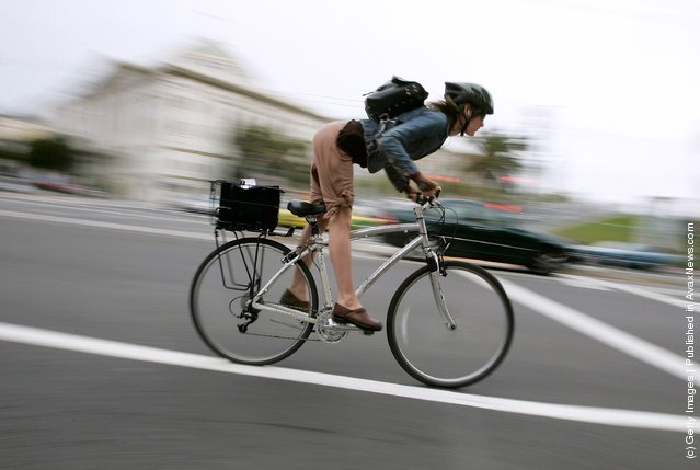 A bicyclist commutes along Market Street
