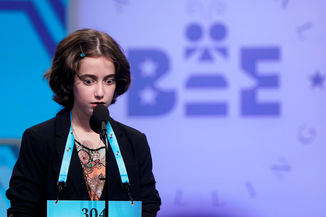 Colette Giezentanner, 12, of St. Louis, Missouri, reacts to spelling a word correctly in the final round of the 92nd annual Scripps National Spelling Bee at National Harbor in Oxon Hill, Maryland, U.S., May 30, 2019. (Photo by Joshua Roberts/Reuters)