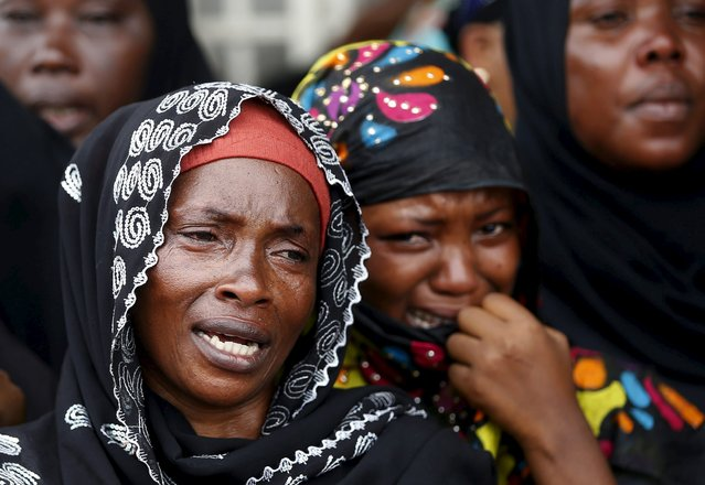 Women cry during a funeral of Zedi Feruzi, the head of opposition party UPD in Bujumbura, Burundi, May 24, 2015. U.N. Secretary-General Ban Ki-moon urged Burundi's government and its opponents not to let violence derail United Nations-sponsored talks, after the killing of the opposition leader prompted some opponents to say they would walk out. (Photo by Goran Tomasevic/Reuters)