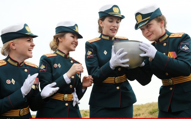 Drinking from a helmet at a graduation ceremony held by the Military University of the Russian Defence Ministry at Moscow's Victory Park in Moscow, Russia on June 15, 2019. (Photo by Gavriil Grigorov/TASS)