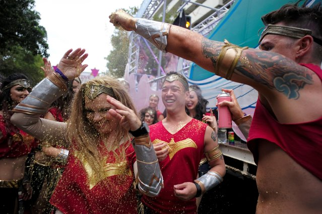 Glitter is sprinkled on a dancing woman during the annual Sydney Gay and Lesbian Mardi Gras festival in Sydney, Australia March 4, 2017. (Photo by Jason Reed/Reuters)