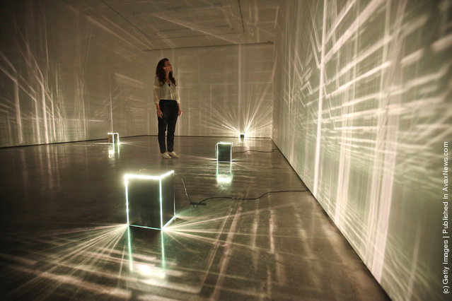 A woman admires an art installation by Kitty Kraus in the new White Cube gallery