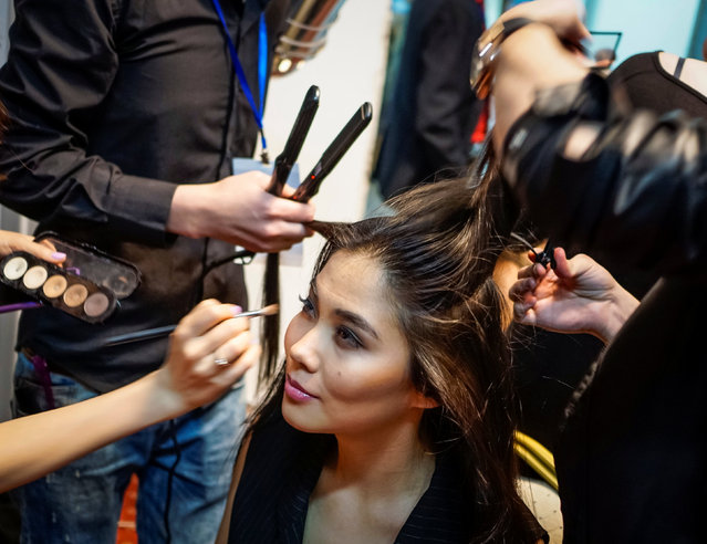 A model has her hair and make up done backstage during Kazakhstan Fashion Week in Almaty, Kazakhstan, April 20, 2016. (Photo by Shamil Zhumatov/Reuters)