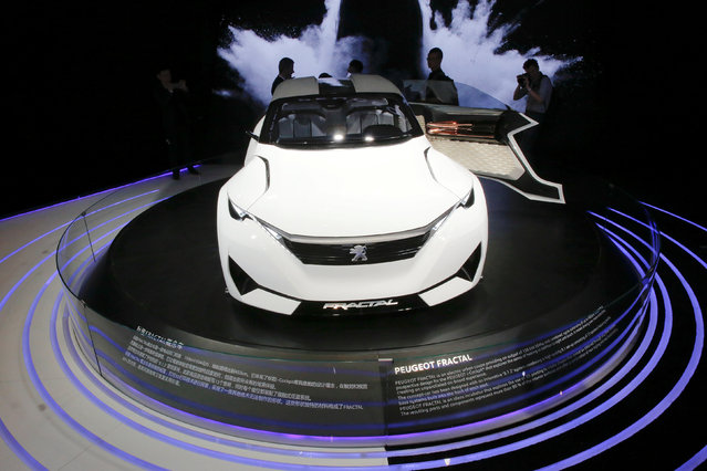 Visitors gather around a Peugeot Fractal electric coupe car during Auto China 2016 auto show in Beijing April 25, 2016. (Photo by Kim Kyung-Hoon/Reuters)