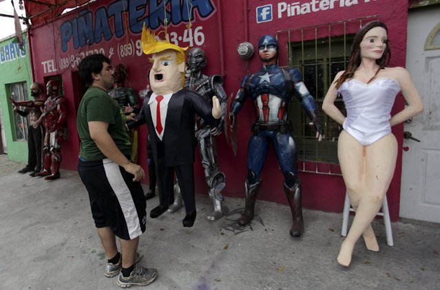 Mexican artisan Dalton Ramirez holds a pinata depicting U.S. Republican presidential candidate Donald Trump outside his workshop in Reynosa, Mexico, June 23, 2015. Days after billionaire Trump accused Mexico of sending criminals to live in the United States, a Mexican artisan has given angry Mexicans an outlet – a Trump pinata they can stuff with candy and beat with a stick. (Photo by Daniel Becerril/Reuters)