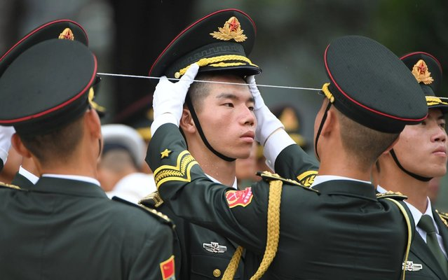 Members of a military honour guard prepare before a welcoming ceremony for Abu Dhabi Crown Prince Mohammed bin Zayed outside the Great Hall of the People in Beijing on July 22, 2019. (Photo by Greg Baker/AFP Photo)