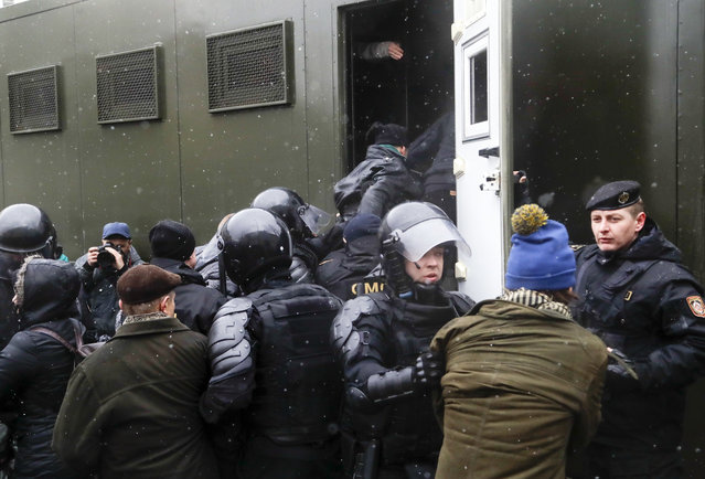 Belarus police detain protesters during an opposition rally in Minsk, Belarus, Saturday, March 25, 2017. (Photo by Sergei Grits/AP Photo)