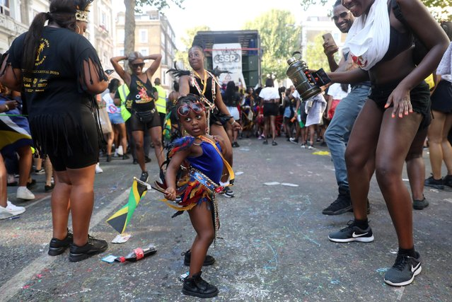 A child reveller dances, holding the Jamaican flag at the Notting Hill Carnival in London, Britain on August 25, 2019. (Photo by Simon Dawson/Reuters)