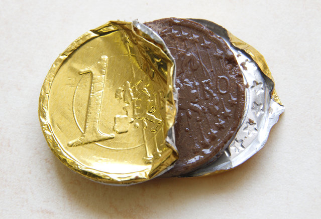 A one Euro coin made of chocolate is displayed in this photo illustration taken in Ljubljana September 11, 2012. (Photo by Srdjan Zivulovic/Reuters)