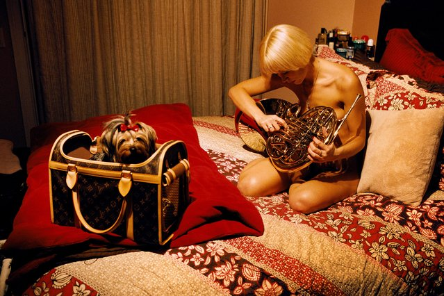 Brooke Taylor, one of the working girls, shares her bedroom with a Yorkshire Terrier named Bella, and likes to play the French horn in her free time, at the Moonlite Bunny Ranch, a legal brothel owned by Dennis Hof, in Lyon County, one of the fews counties in the USA which permits legalized prostitution. (Photo by Stephan Gladieu/Getty Images)