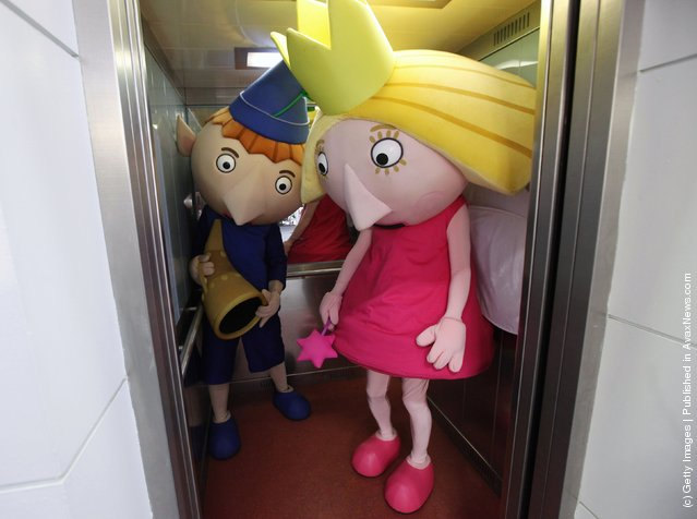 People dressesd as toys 'Ben and Holly' use a lift at the 2012 London Toy Fair