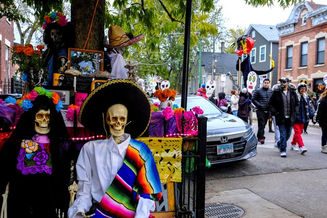 The Mexican-American community of Pilsen celebrates Day of the Dead with a procession through their neighborhood decorated with altars in Chicago, Illinois, November 2, 2019. (Photo by Maria Alejandra Cardona/Reuters)