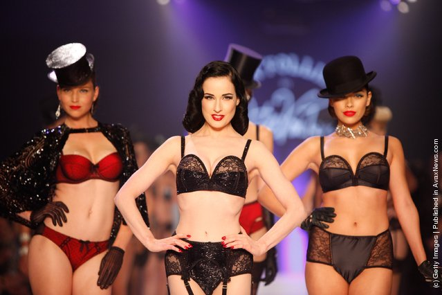 Dita Von Teese and models showcases designs by Von Folies by Dita Von Teese on the runway during L'Oreal Melbourne Fashion Festival