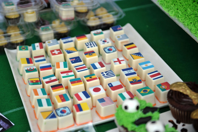 Football themed cakes and sweets on sale during the celebrations at Trafalgar Square on June 12, 2014 in London, England. The 20th FIFA Football World Cup kicks off tonight in Brazil and will run until July 13th. 32 national teams will take part in the tournament and the games will be played across 12 cities. (Photo by Bethany Clarke/Getty Images)