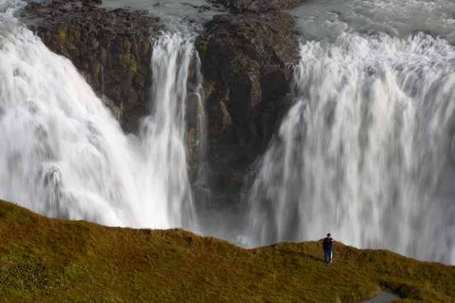 A tourist takes a selfie photograph in an area forbidden to walking, overlooking the waterfalls in Gullfoss, Iceland on September 16, 2019. (Photo by Chris Helgren/Reuters)