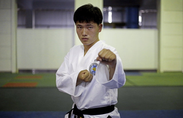 """In this April 17, 2017, photo, Won Dae Chol, 20, poses for a portrait at the Taekwando Palace in Pyongyang, North Korea. His motto: """"I want to win medals in this sport to please our leader Kim Jong Un"""". (Photo by Wong Maye-E/AP Photo)"""