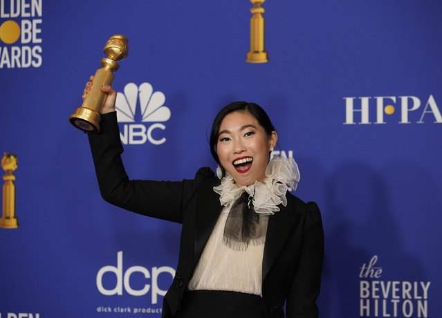"Awkwafina poses in the press room with the award for best performance by an actress in a motion picture, musical or comedy for ""The Farewell"" at the 77th annual Golden Globe Awards at the Beverly Hilton Hotel on Sunday, January 5, 2020, in Beverly Hills, Calif. (Photo by Mike Blake/Reuters)"