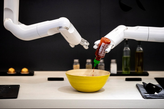 """The Samsung intelligent robot """"Bot Chef"""" is demonstrated at the manufacturer's booth during the 2020 International Consumer Electronics Show (CES) at the Las Vegas Convention Center in Las Vegas, Nevada, USA, 08 January 2020. (Photo by Etienne Laurent/EPA/EFE)"""