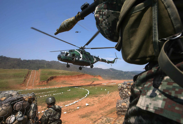 A helicopter of the Peruvian Armed Forces lands at Valle Esmeralda military base in Junin province, Peru, Peru, 05 August 2015. The Peruvian Armed Forces continues operations to fight against the remnants of the Shining Path rebel group. (Photo by Ernesto Arias/EPA)