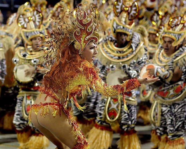 A dancer from the Mocidade Alegre samba school performs in Sao Paulo