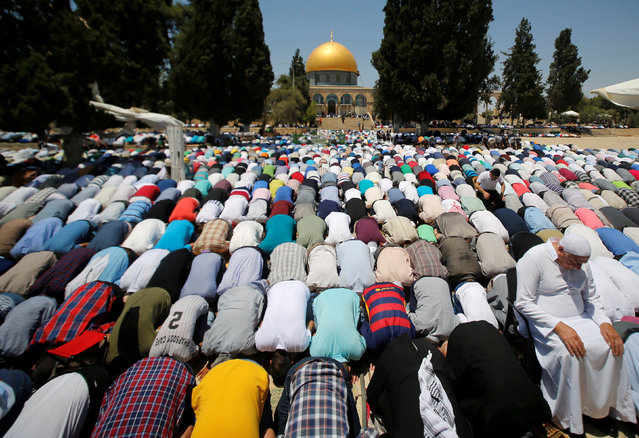 The Dome of the Rock is seen in the background as Palestinians pray on the third Friday of the holy fasting month of Ramadan on the compound known to Muslims as Noble Sanctuary and to Jews as Temple Mount, in Jerusalem's Old City June 24, 2016. (Photo by Ammar Awad/Reuters)