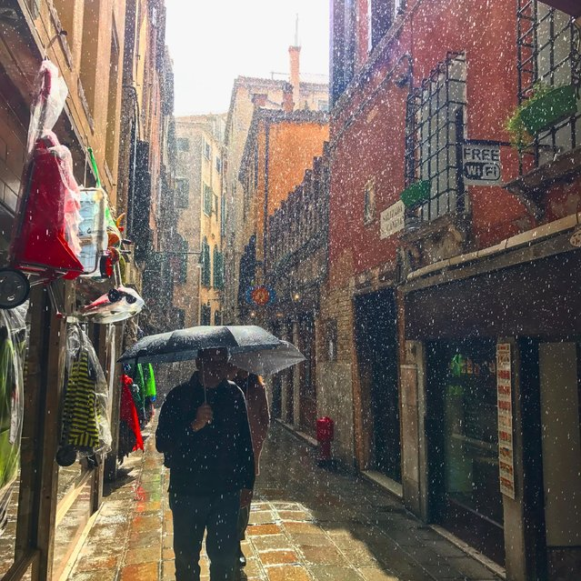 "Chris Tereyla, 37, of Frederick, Md., was on his honeymoon in Italy when he took this photo in Venice. ""One sunny afternoon it suddenly started raining. I was able to capture this picture of a sunny, rainy day¨. (Photo by Chris Tereyla/2017 Washington Post Travel Photo Contest)"