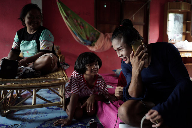 Muay Thai boxer Nong Rose Baan Charoensuk, 21, who is transgender, spends time with her family at her house in Phimai district in Nakhon Ratchasima province, Thailand, July 18, 2017. (Photo by Athit Perawongmetha/Reuters)