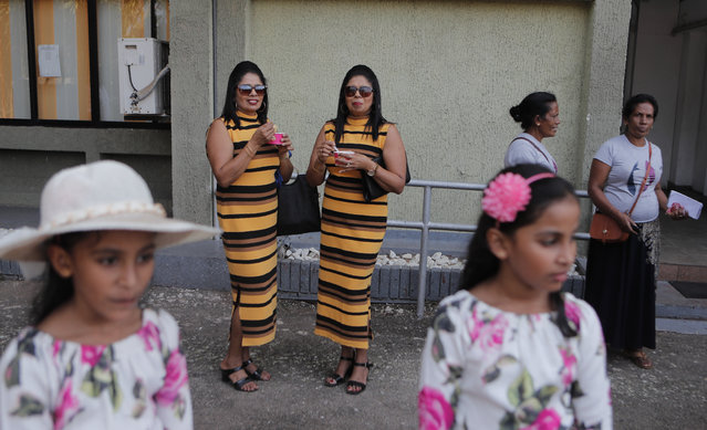 Sri Lankan twins participate in an event organized to attempt setting up a record for the largest twins gathering, in Colombo, Sri Lanka, Monday, January 20, 2020. Sri Lankan Twins, the organizers of the event which was held at a sports complex stadium claim to represent 28,000 twin and multiples. (Photo by Eranga Jayawardena/AP Photo)