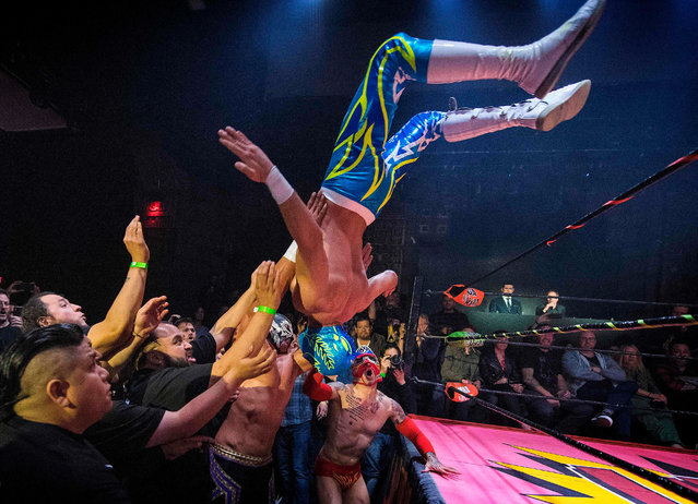 "Nacho Libre wrestlers perform during the Lucha Vavoom ""Valentines Day"" show at the Mayan Theatre, California, on February 12, 2020. Lucha Vavoom combines Mexican Nacho Libre wrestling with cabaret and burlesque acts to make a uniquely Los Angeles variety show. (Photo by Mark Ralston/AFP Photo)"