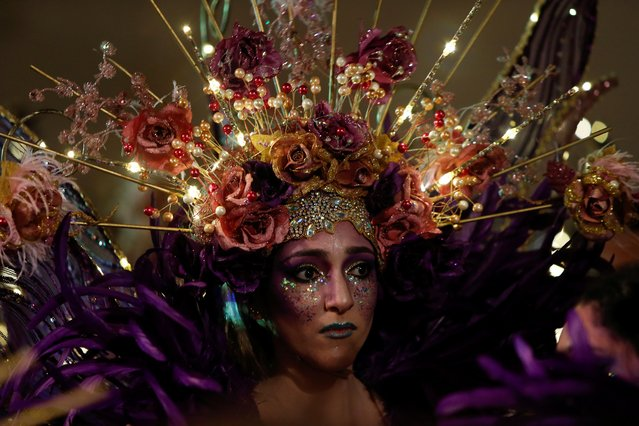 A dancer waits to perform in the carnival parade in Valletta, Malta on February 23, 2020. (Photo by Darrin Zammit Lupi/Reuters)