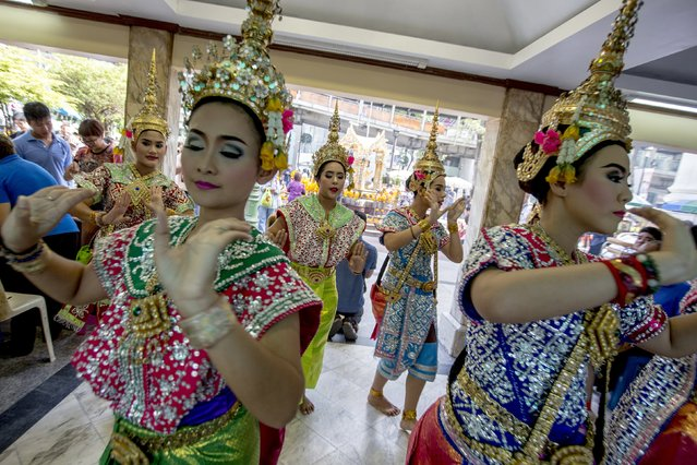 Thai classical dancers perform at the Erawan shrine, the site of Monday's deadly blast, in central Bangkok, Thailand, August 21, 2015. (Photo by Athit Perawongmetha/Reuters)