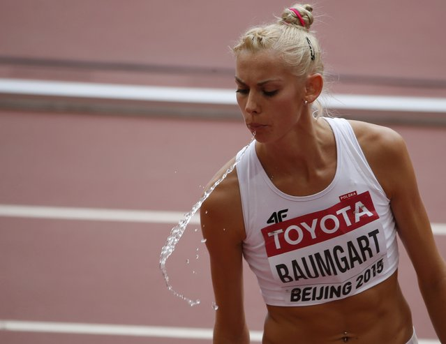 Iga Baumgart of Poland spits before the women's 400 metres heats during the 15th IAAF World Championships at the National Stadium in Beijing, China August 24, 2015. (Photo by David Gray/Reuters)