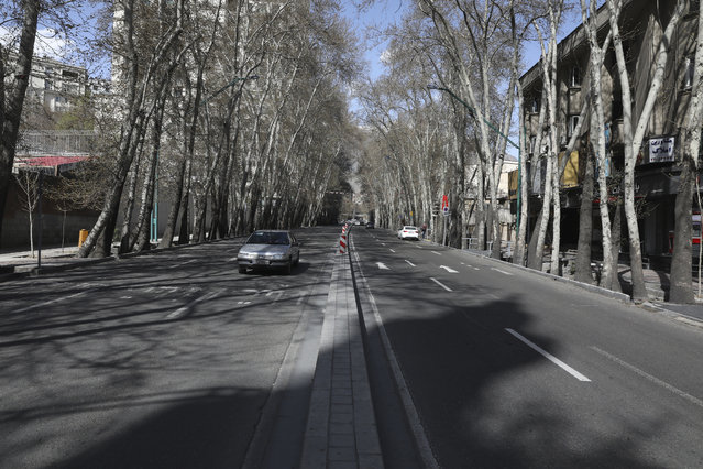 """Cars drive in Vali-e-Asr St. which usually has congested traffic in northern Tehran, Iran, Friday, March 20, 2020, on the first day of Iranian New Year, called Nowruz, or """"New Day"""" in Farsi, the Persian holiday marking the the spring equinox. The new coronavirus has cut into the ancient Nowruz and has further slowed the Islamic Republic's economy. (Photo by Vahid Salemi/AP Photo)"""