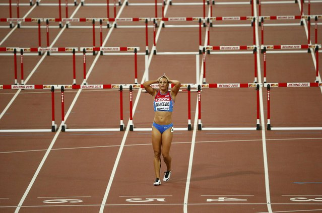 Andrea Ivancevic of Croatia reacts after tripping on a hurdle in the women's 100 metres hurdles semi-final during the 15th IAAF World Championships at the National Stadium in Beijing, China August 28, 2015. (Photo by David Gray/Reuters)