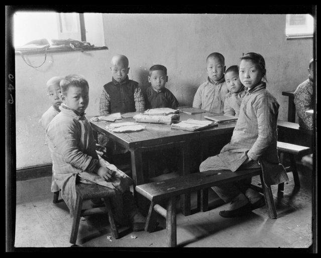 Pusiang Children at Table. China, Hangzhou, 1917-1919. (Photo by Sidney David Gamble)