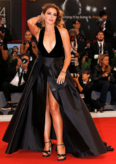 """Actress Gerini poses at the red carpet for the movie """"Ammore e malavita"""" during the 74th Film Festival in Venice, Italy on September 6, 2017. (Photo by Alessandro Bianchi/Reuters)"""